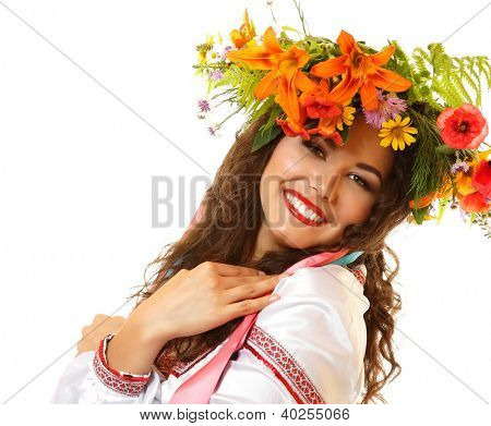 Beautiful ukrainian young woman in garland of summer flowers and native costume dancing on Slavic holiday Ivan-Kupala, on white background