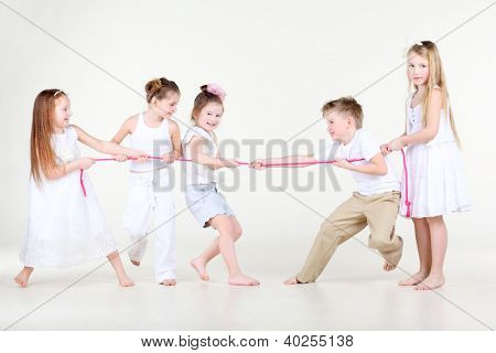 Four happy little girls and one boy in white clothes draw over pink rope.