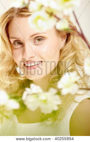 Charming girl with curly hair looking at camera