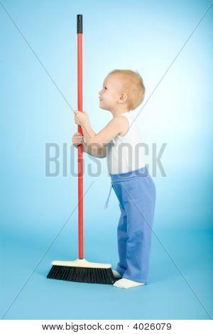 Joyful Boy With Cleaning Swab Over Blue