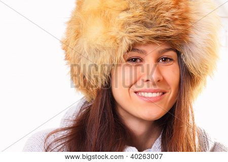 Young Brunette Woman In A Fur Hat