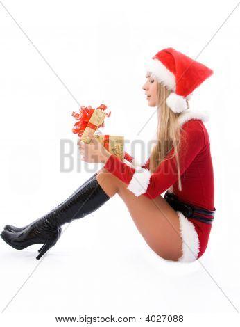 Beautiful Woman Opening A Christmas Present
