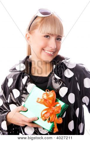 Stylish Woman With A Present In Her Hand