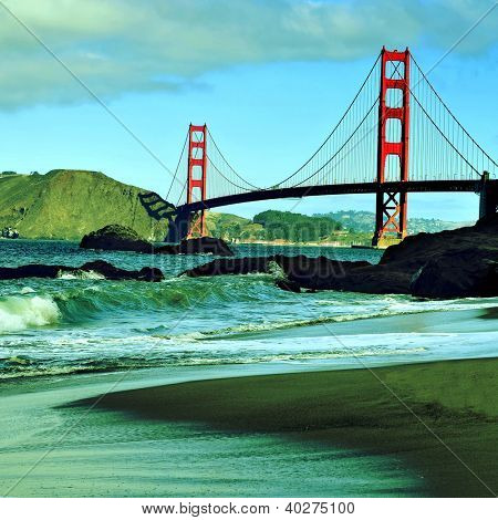 A view of Golden Gate Bridge from Baker Beach in San Francisco, United States, with a retro effect