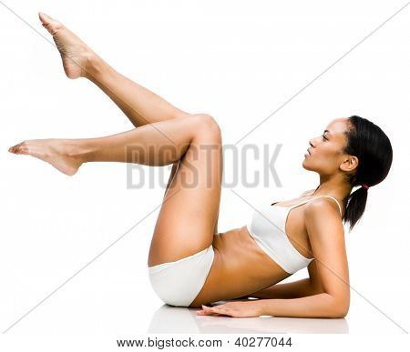 young beautiful girl with perfect lags  sits on a white background