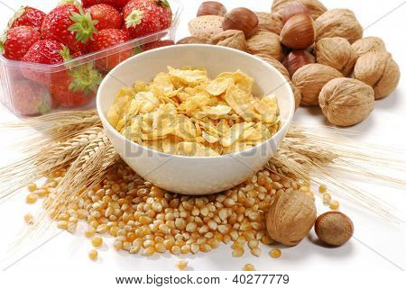 Corn flakes cereal bowl and fruit ingredients.