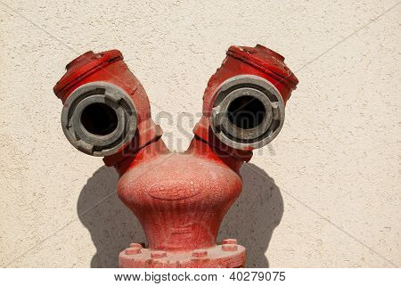 Red Fire Hydrant By A Wall