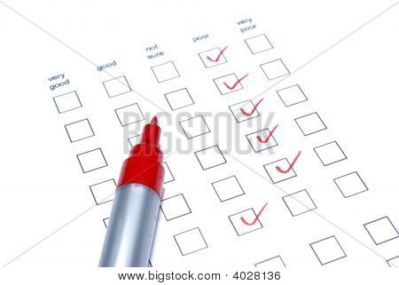 Red Marker And Survey Checklist Isolated On White Background