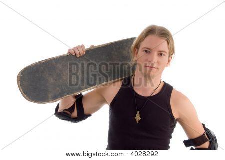 Handsome Guy Holding Skateboard On His Shoulder