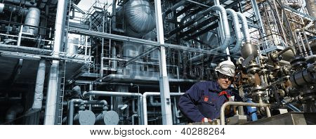 oil industry with worker, machinery and pipelines, panoramic view