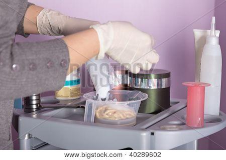 Hairdresser Preparing Peroxide For Hair Dyeing Treatment