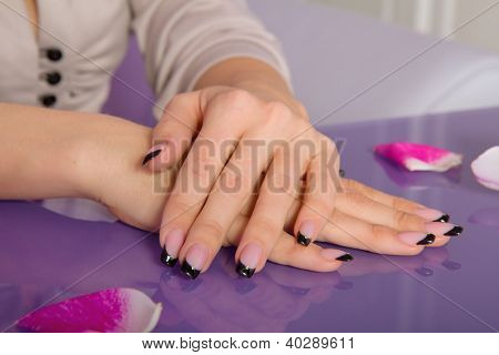 Woman Hands With French Manicure With Crystals