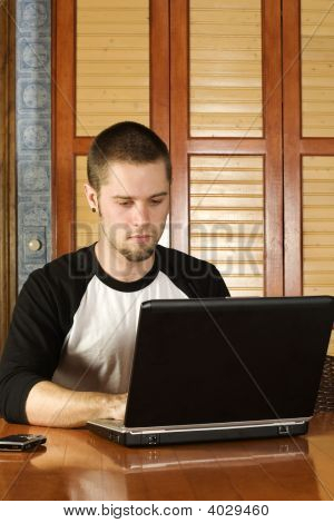 Young Male Working On Laptop