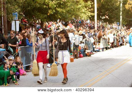 Two Contemporary Witches Walk Halloween Parade Route