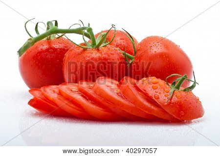 juicy tomato slices and panicle with drops isolated against a white background