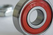 stock photo of ball bearing  - a roller bearing from a skateboard wheel rated at ABEC 5  - JPG