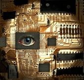 stock photo of human eye  - Circuit board with Human eye embedded into one of the IC - JPG