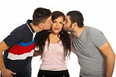 foto of threesome  - Two guys kissing friend woman cheeks isolated on white background - JPG