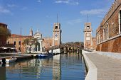 foto of arsenal  - The Arsenal in Venice Italy in a bright sunny day with a colorful reflections over the water surface in the chanel - JPG