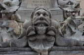 image of gruesome  - Grotesque mask on the fountain of Piazza della Rotonda in fron of the Pantheon in Rome Italy - JPG