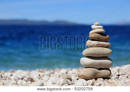 Balancing stones with sea in background