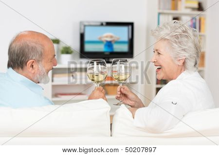 Senior Couple Celebrating With White Wine