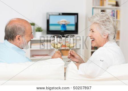 Senior Couple Celebrating With White Wine