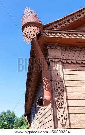 The Old Rainwater Downpipe On Wooden House
