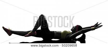 one  woman exercising fitness stretching lying on back in silhouette  on white background