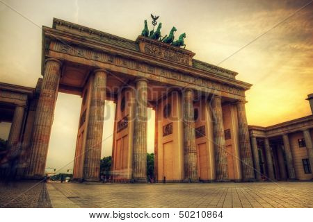 Brandenburg Gate. German Brandenburger Tor in Berlin, Germany. Sunset with beautiful sunbeams