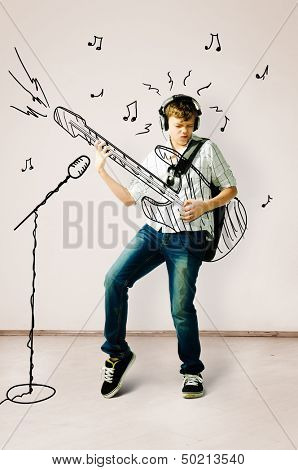 teenager is playing on drawn guitar at concert