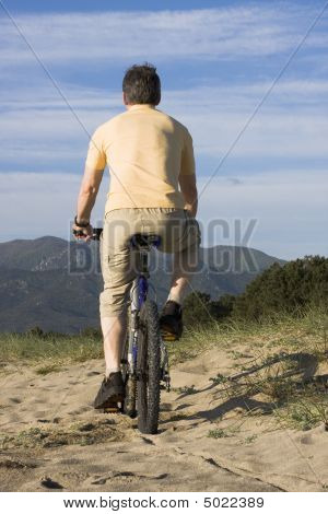 Man Riding Bicycle