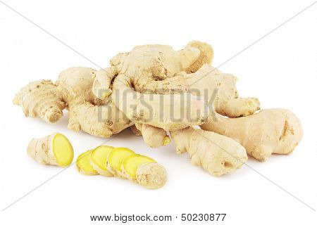 Ginger roots with ginger slices on white