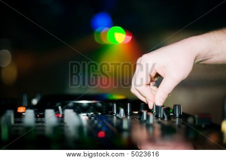 Close-up Of Deejay's Hand And Turntable