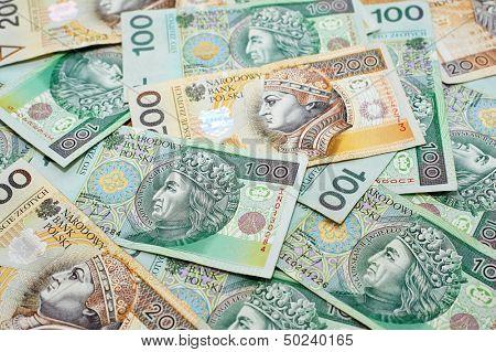 Poland currency. Close-up polish zloty 100 and 200 banknotes