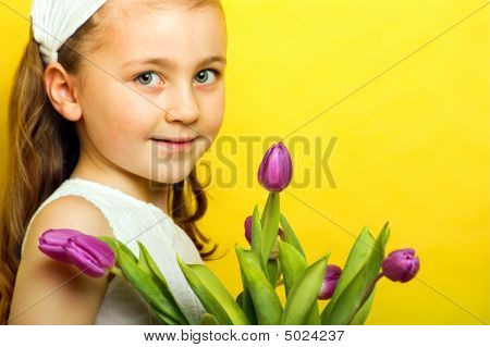 Young Girl With Tulips At Spring