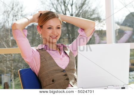 Business Woman Is Working On A Table With A Laptop