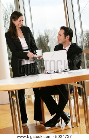 Business Man Is Getting A Cup Of Coffee From His Secretary