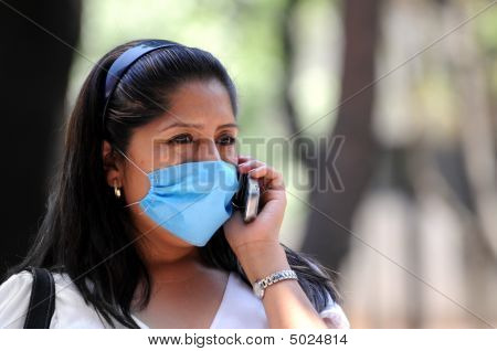Woman Talking On Phone With Face Mask