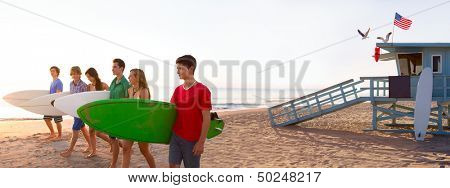 Surfer teenagers boys and girls walking on California beach at Santa Monica [ photo-illustration]