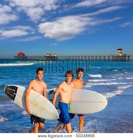 Boys surfers group coming out from Huntington beach California [ photo-illustration]