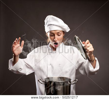 surprised woman chef holding a lid