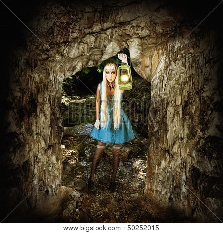 Woman Illuminates Path In A Dark Cave