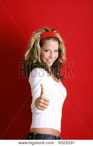 Happy Woman Is Smiling With The Thumb Up