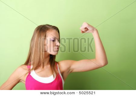 A Sporty Woman Is Flexing Her Muscle
