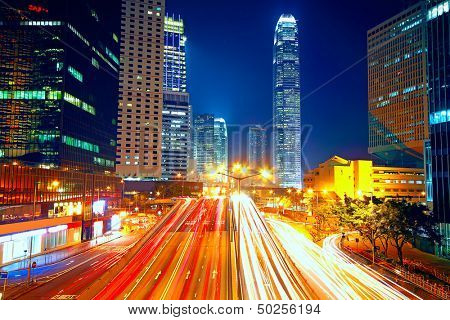 Colorful city night with lights of cars motion blurred in hong kong