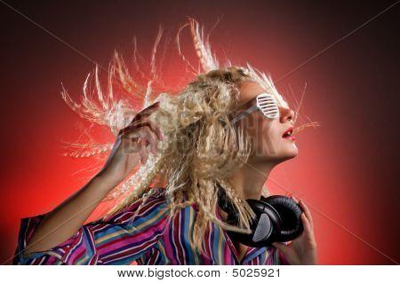 Beautiful Woman With Headphones Dancing