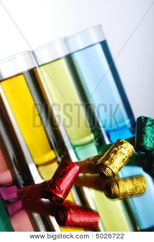 Multi-coloured Shot Glasses With Party Blowers