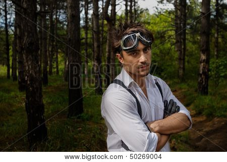 Portrait of man with motorcycle goggles and gloves