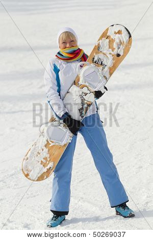 Young dissatisfied woman with snowboard